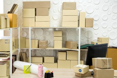 Storehouse of parcel room ready for packaging products to deliver out Standard-Bild - 131996980