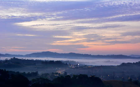Beautiful Landscape of mountain layer in morning sun ray and winter fog at Khao Kao, Petchabun, Thailand