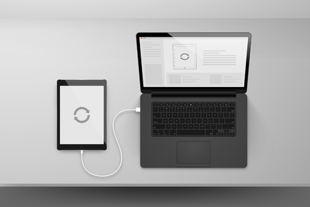 plugged: Laptop or notebook black design mock up sync data with tablet by cable on table illustration Illustration