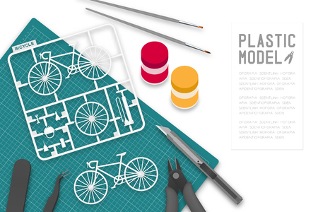 Plastic model with tool kit on cutting mat, bicycle concept design illustration isolated on white background with copy space Ilustração