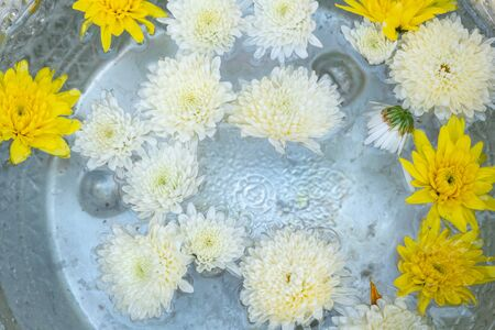 Holy water in silver bowl of buddhism in temple at thailand yellow and white color