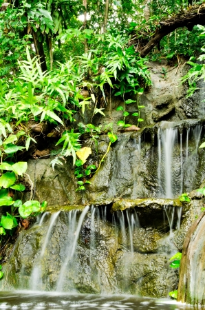 swerve: Waterfall in Sankhampang Hot Springs, tropical vegetation in the Springs garden,Chiangmai,Thailand Stock Photo