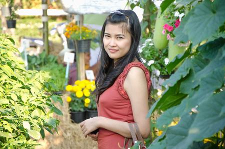 politely: woman in garden Stock Photo
