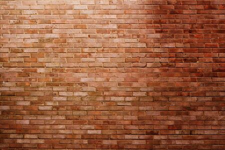 oriented: Landscape oriented brick wall in spotlight with shadows, perfect as a background Stock Photo