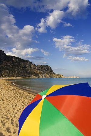tsampika: A colourful beach umbrella on Tsambika beach on Rhodes Island, Greece Stock Photo