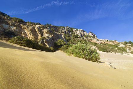 tsampika: Sand dune and rocks near Tsampika beach in Rhodes Island, Greece Stock Photo