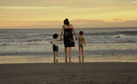 Family watching sunset