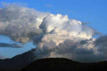 foreshadowing: Extremly dangerous stormy clouds  above mountain                               Stock Photo