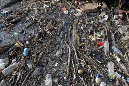 Dangerous toxic garbage floating on water