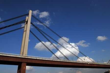 Modern bridge above river against blue sky and white clouds Stock Photo - 2714346