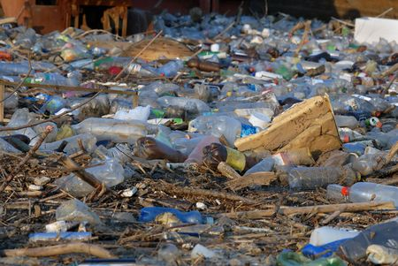 ecological problem: Dangerous toxic garbage and industrial waste floating in river, pollution