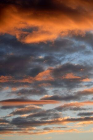 foreshadowing:  cloudscape scene, beautiful warm colored clouds