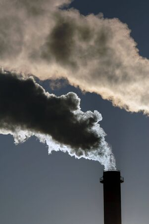 iron oxide: Dangerous toxic clouds from the industrial chimney, pollution concept Stock Photo