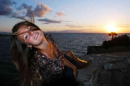 Attractive female enjoying a beautiful  sunset Stock Photo - 2842392