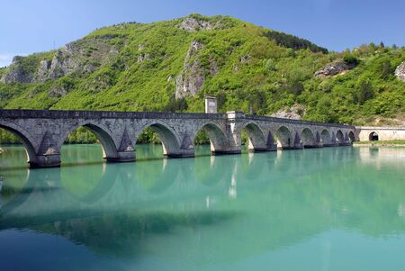 Old stone bridge in Visegrad, built in 1571 by Mehmed Pasha Sokolovic, Bosnia, Balkan photo