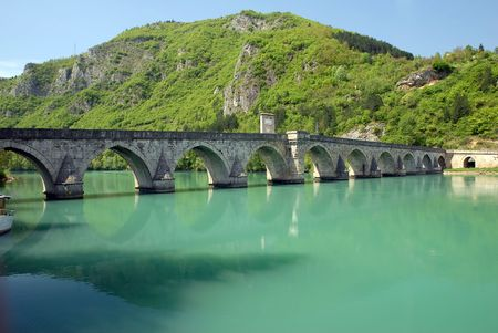 Old stone bridge in Visegrad, constructed in middle age, Serbia, Yugoslavia photo