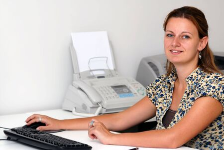Young attractive female businesswoman in her office