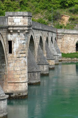 visegrad: Ancient stone bridge in Visegrad, Serbia, Yugoslavia Stock Photo