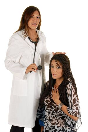 Young attractive female doctor with patient, studio, isolated over white photo