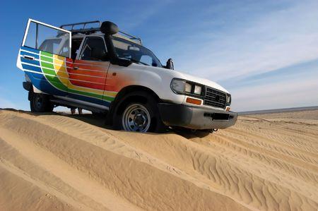 Dune ride with 4wd vehicle in Sahara desert                                 Stock Photo