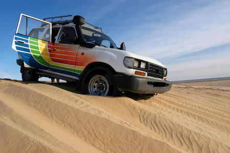Dune ride with 4wd vehicle in Sahara desert                                 Stock Photo