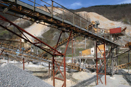 separators: Close up image of modern quarry, rock separators and machinery visible