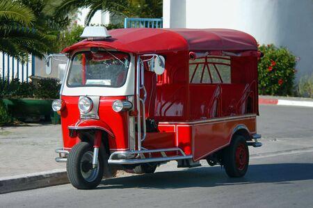 Red colored Tuk Tuk vehicle in the Tunisian city Hammamet