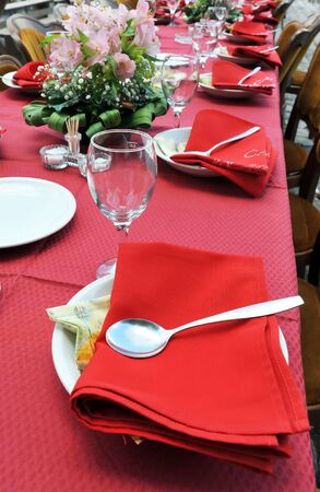 red tablecloth: Empty served restaurant table with red tablecloth Stock Photo