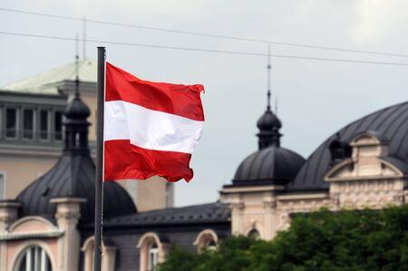 salzburg: Waving flag of Austria with Salzburg panorama in background
