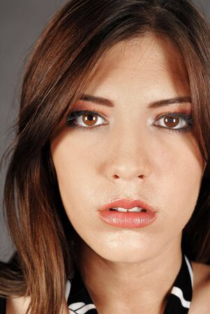 Young attractive female beauty, makeup concept, closeup of face photo