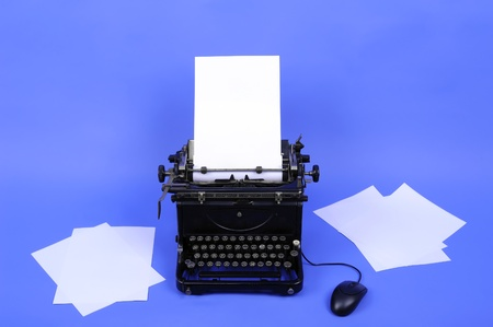 Vintage typewriter with loaded paper and computer mouse Stock Photo - 9621339