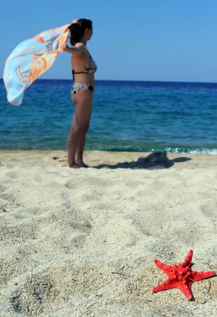 sithonia: Beach scene, attractive female enjoying summer vacation in Sithonia, Greece