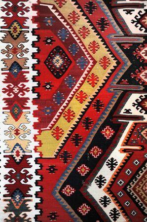 Hand woven kilim pattern, close up view photo