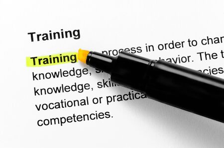 Training text highlighted in yellow, under the same heading Stock Photo