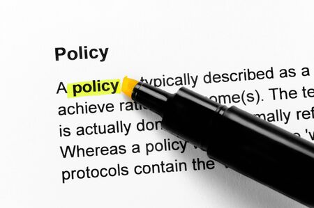 Policy text highlighted in yellow, under the same heading