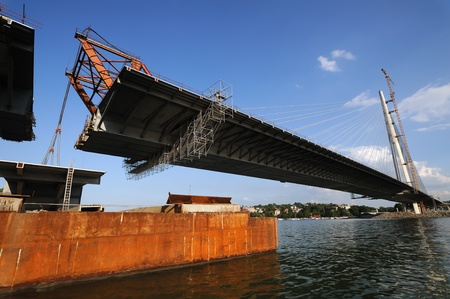 build up: Bridge construction, lifting last segment to the position Editorial