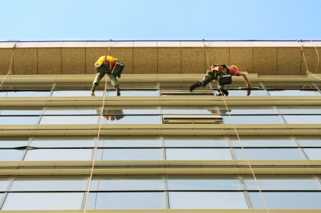 Group of washers wash the glass facade of modern skyscraper Stock Photo - 13751468