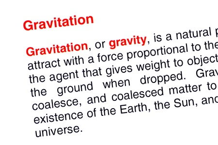 Gravitation text highlighted in red under the same heading Stock Photo