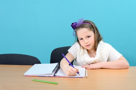 procesed: Young and happy girl doing her school work, procesed from Raw