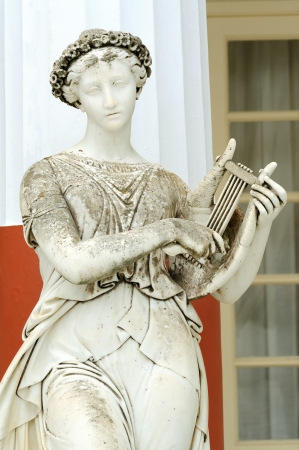 Statue of a Muse Terpsichore in the balcony of Achillion princess Sissy's palace in Corfu, Greece. Terpsichore was the Muse of the dance and the dramatic chorus