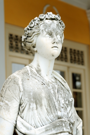 Statue of a Muse Euterpe in the balcony of Achillion princess Sissys palace in Corfu, Greece. Euterpe, the so-called Giver of Pleasure, was the Muse of Music. photo