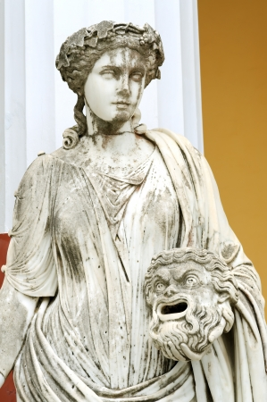 muse: Statue of a Muse Melpomene in the balcony of Achillion princess Sissys palace in Corfu, Greece. Melpomene was mainly considered as the Muse of tragedy Stock Photo