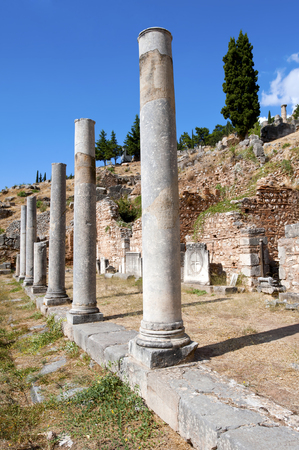 Column and ruins of the ancient city Delphi, Greece photo