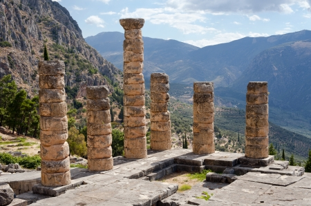 The ruins of Temple of Apollo in the archaeological site of Delphi in Greece photo