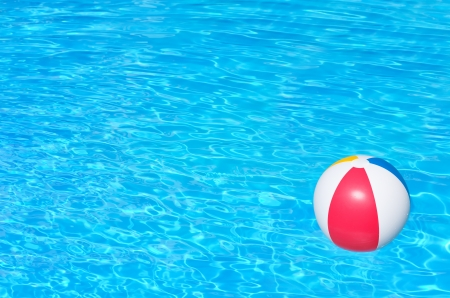 furlough: Inflatable colorful ball floating in a swimming pool
