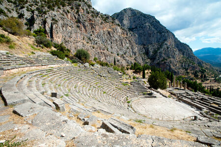 The ruins of ancient theater in the archaeological site of Delphi in Greece photo