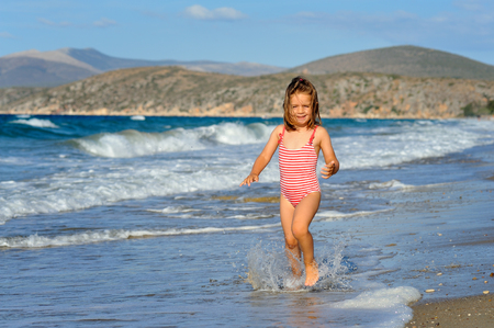 sithonia: Smiling toddler girl at beach Stock Photo