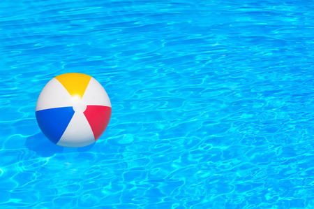 pool: Inflatable ball floating in swimming pool