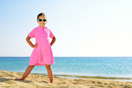 sithonia: Adorable girl dancing on the beach
