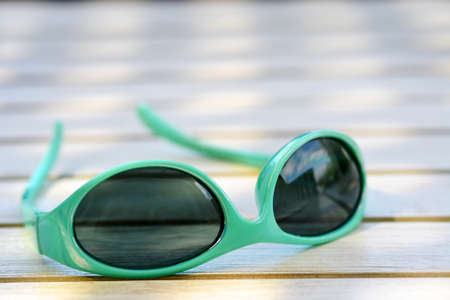 Sunglasses on the vintage wooden table Stock Photo